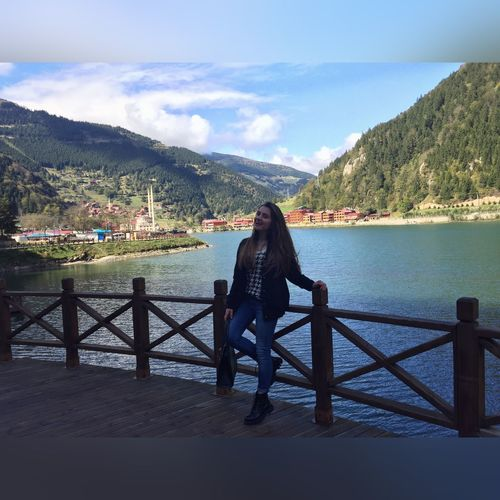 Mountain Water Real People Beauty In Nature Mountain Range Railing One Person Lifestyles Lake Full Length Leisure Activity Person Beautiful Woman Sky Outdoors Rear View