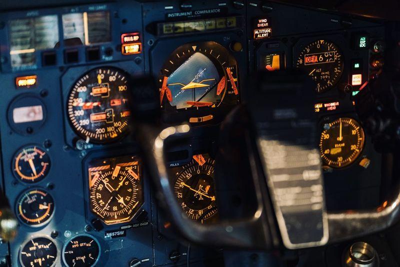 Close-up of airplane seen through car window