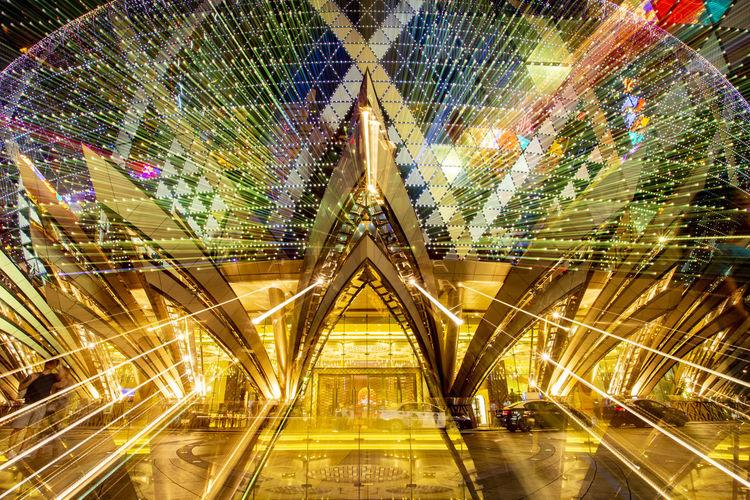 Digital composite image of illuminated lights at night