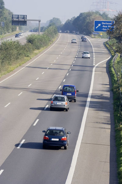 tailgating on a three-lane autobahn - oberhausen, germany A42 Autobahn Car Danger Driving Exit Freeway Germany High Angle View Highway Highways Highways&Freeways Land Vehicle Motion No People NRW Oberhausen Road Road Marking Ruhrgebiet Speed Tailgaiting The Way Forward Traffic Transportation