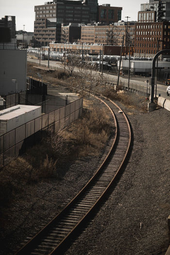 High angle view of railroad tracks by buildings in city