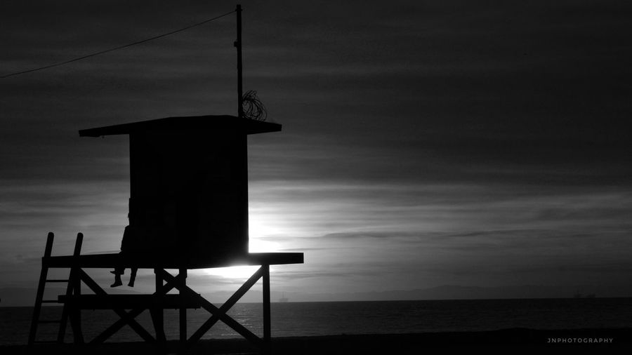 Chasing Sunsets. Newport Beach, CA | Jan 17, 2017. Sea Sky Nature Horizon Over Water Built Structure Tranquility Cloud - Sky Water Beach Scenics Silhouette Lifeguard Hut Architecture Sunset Beauty In Nature No People Outdoors Day Beach Photography Southern California Beach Life Jnphotography Tranquility Dramatic Sky Blackandwhite