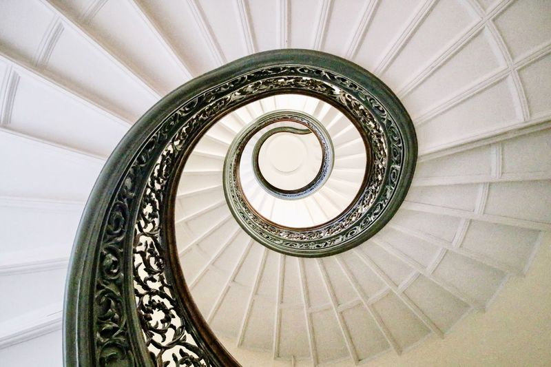 EyeEm Selects Swirl Built Structure Architecture Spiral Staircase Spiral Staircase Steps And Staircases Railing Architectural Feature Directly Below Low Angle View Ornate Ceiling Indoors  Design Building Concentric The Architect - 2018 EyeEm Awards The Still Life Photographer - 2018 EyeEm Awards My Best Photo