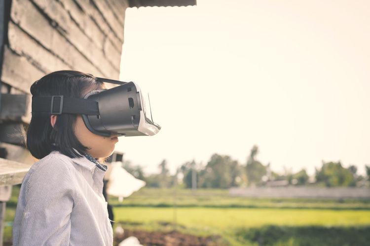 Close-up of child wearing virtual reality simulator