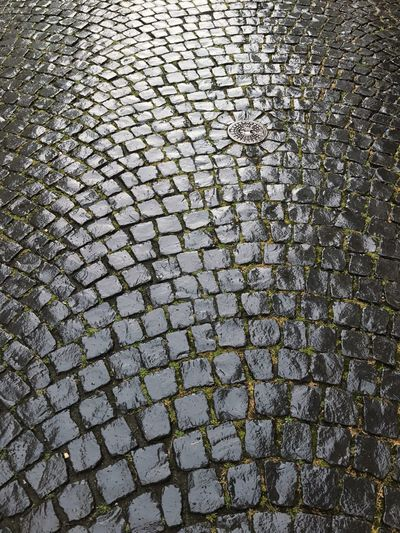 Wet Cobblestones Textures and Surfaces Cobblestone Streets Wet Wet Road Cobblestone Pattern Full Frame Backgrounds Textured  No People Day Outdoors