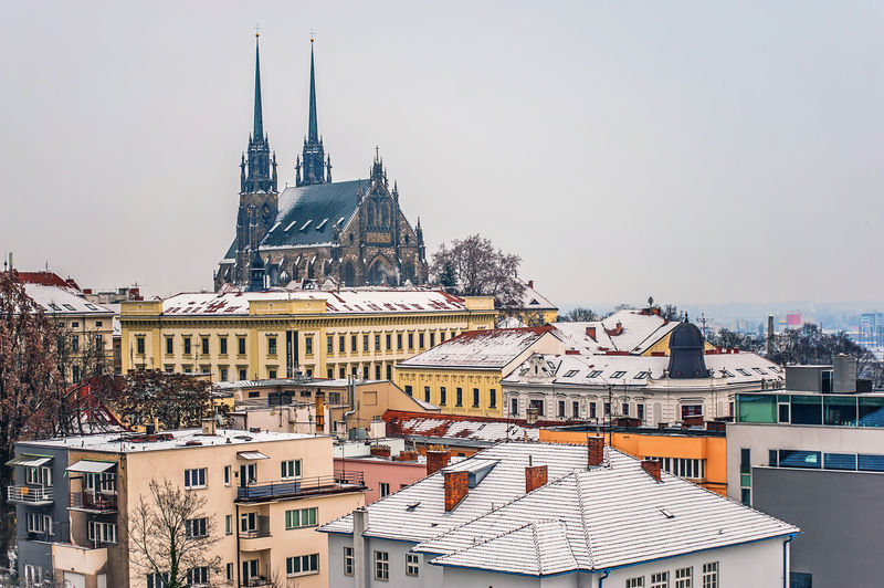 Cathedral amidst cityscape during winter