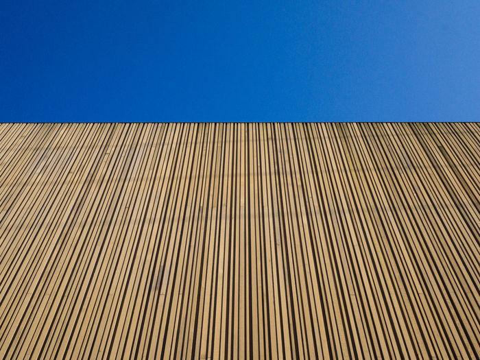 wooden wall against a blue sky Architecture Blue Sky Brown Built Structure Clear Sky Close-up Day Low Angle View No People Pattern Textured  Water