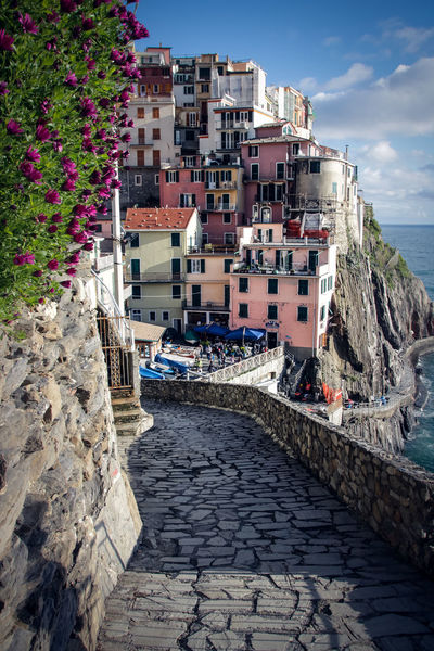 Cinque Terre Architecture Building Building Exterior Built Structure City Colorsplash Day Manarola Nature No People Outdoors Paved Path Plant Residential District Rock Rock - Object Sea Sky Solid Sunlight Town TOWNSCAPE Village Water