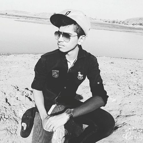 In my veins Sunglasses Lifestyles Leisure Activity Front View Person Casual Clothing Young Adult Fashion Sitting Cool Attitude Three Quarter Length Relaxation Person Confidence  Water Person Handsome Fashionable Outdoors First Eyeem Photo