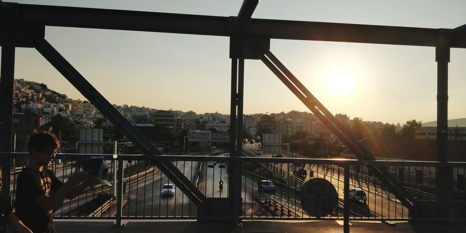OnePlus 5t 3XSPUnity Athens, Greece Athens City Cityscape Golf Club Sunset Bridge - Man Made Structure Rollercoaster Sky Architecture Built Structure Suspension Bridge Office Building Steel Cable Chain Bridge Engineering The Street Photographer - 2018 EyeEm Awards The Traveler - 2018 EyeEm Awards