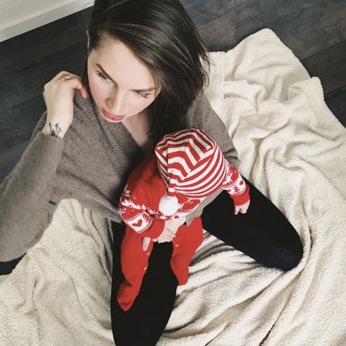 One Person Young Adult Indoors  Young Women Lifestyles High Angle View Real People Relaxation Leisure Activity Casual Clothing Home Interior Lying Down Three Quarter Length Bedroom Beautiful Woman Mother And Son Mother And Child Motherhood Childhood Newborn