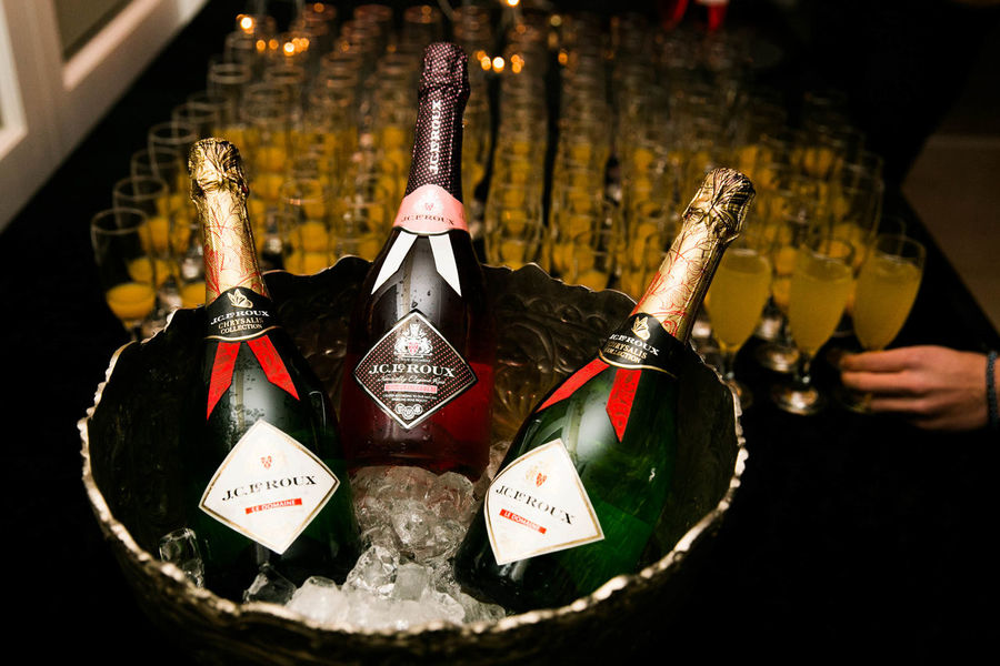 Champagne Event Belief Bottle Close-up Communication Container Focus On Foreground Food Food And Drink Hand Hanging Holding Human Body Part Human Hand Indoors  Nightclub Nightlife One Person Place Of Worship Real People Religion Still Life Text