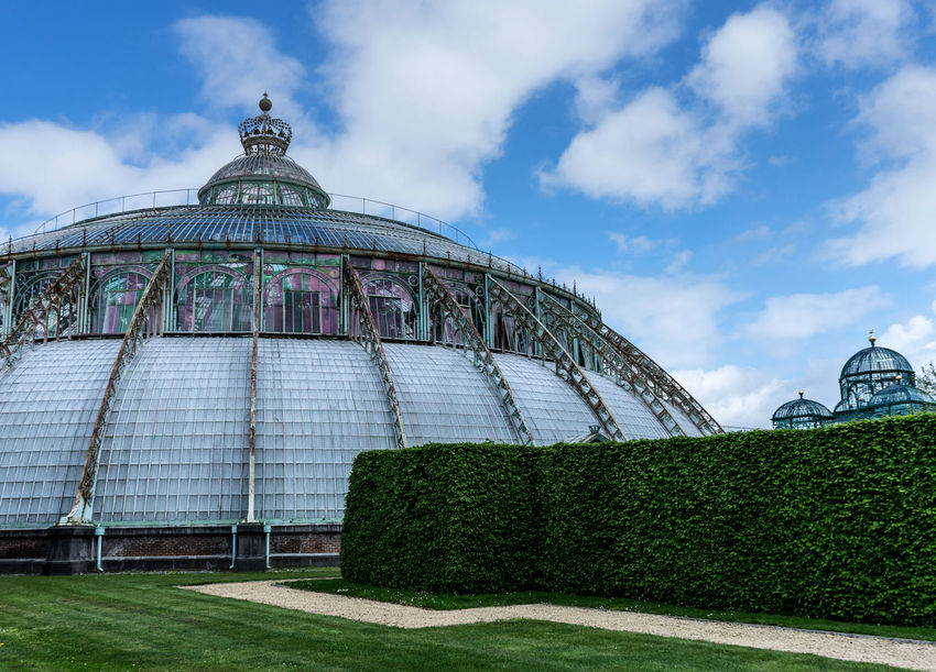 Serres De Laeken (Brussels). Architecture Belief Building Exterior Built Structure City Cloud - Sky Day Dome Grass History Low Angle View Nature No People Outdoors Place Of Worship Plant Sky Tourism Travel Travel Destinations
