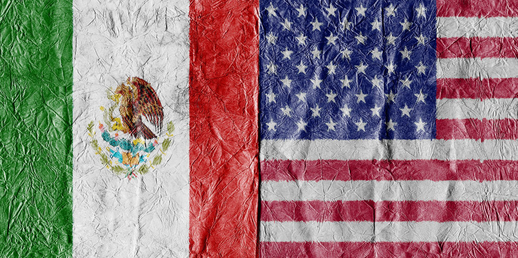 Full frame shot of mexican and american flags