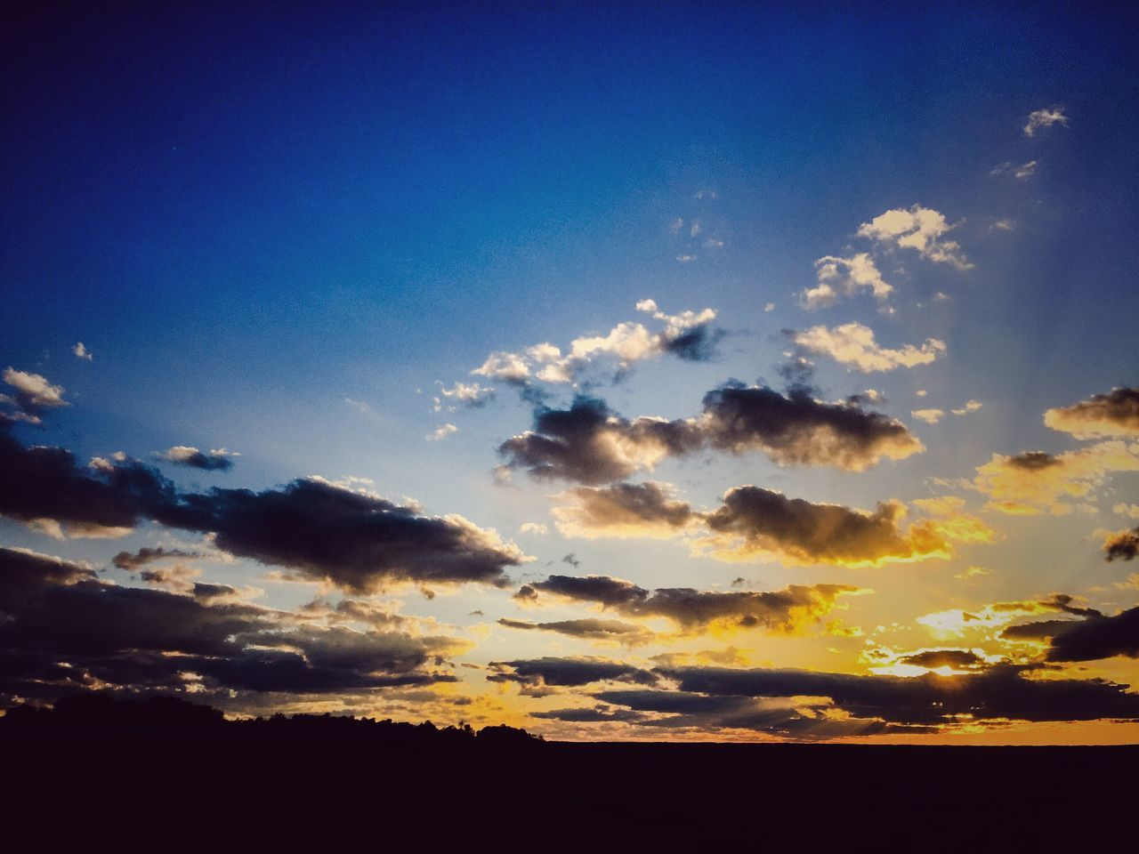 tranquility, nature, tranquil scene, sunset, beauty in nature, sky, scenics, silhouette, idyllic, cloud - sky, no people, blue, outdoors, day