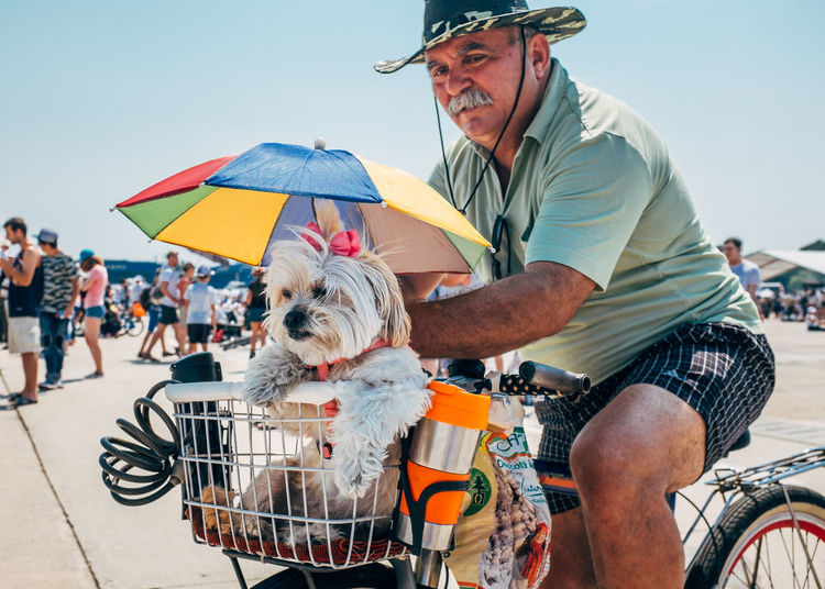 Airshow Bucharest Moments Romania Sunny Airport Bias2017 Bicycle Day Dog Domestic Animals Fan Heat Horizon Over Water Mammal One Animal One Person Outdoors People Pets Real People Street Street Photography Streetphotography Umbrella
