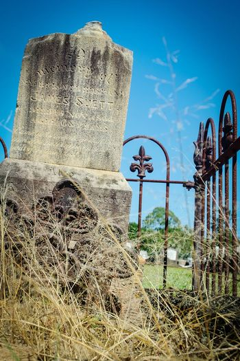 Sky Close-up No People Outdoors Gravemarkers Nikon D5100  Cemetery Photography Peaceful Graveyard Beauty Iron Fence Grass And Sky Weathered Stone
