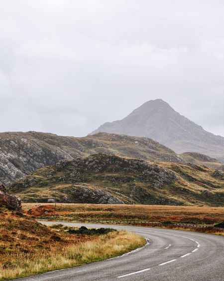 highland road EyeEmNewHere Scotland The Week On EyeEm Beauty In Nature Day Landscape Mountain Mountain Range Mountain Road Nature No People Outdoors Road Scenics Scottish Highlands Sky Tranquil Scene Tranquility Transportation Winding Road EyeEmNewHere