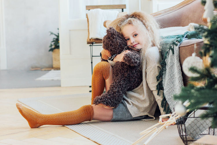Cute girl sitting with toy