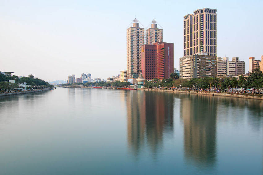 Kaohsiung, Taiwan - December 18,2014: Panoramic view of the Love River of Kaohsiung from the bridge on Wufu Road Architecture ASIA Buddha Building Building Exterior Built Structure China City Cityscape Day Iconic Buildings Kaohsiung Love River Office Building Outdoors Reflection River Rock Sky Skyscraper Taiwan Tall - High Urban Skyline Water Waterfront