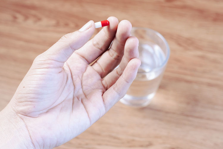 drug Healthy Pill Tablet Capsule Kaplet Human Hand Science Body Part Hand Healthcare And Medicine Close-up Pill Container Nutritional Supplement Aspirin Taking Medicine Vitamin Prescription Medicine Acid Pill Bottle Birth Control Pill Antibiotic