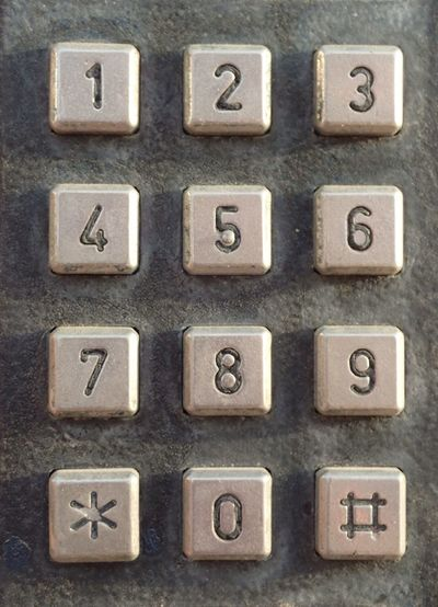Close-up of vintage pay phone