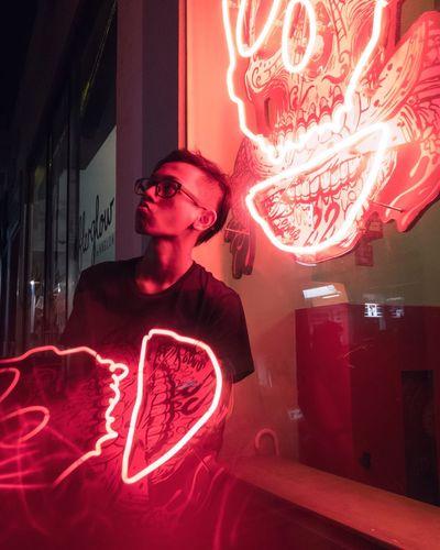 Midsection of man in illuminated nightclub