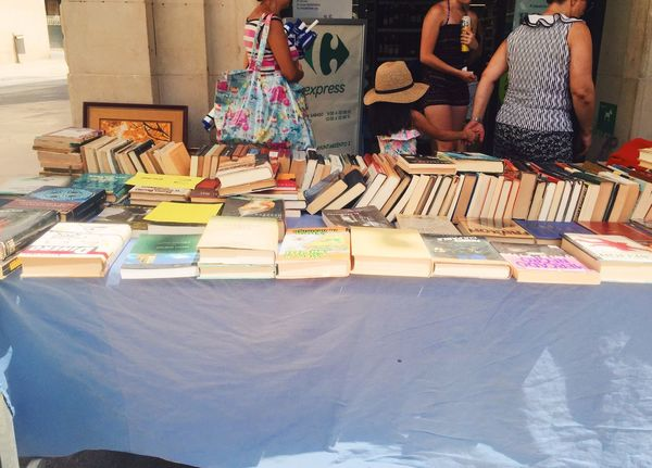 Exterior View Outdoors Real People Women Books Market Bookstore Full Length Market Stall Marketplace Real People, Real Lives Small Business Text For Sale Choice Two People Retail  Paper Day Standing Large Group Of Objects Cardboard Box Indoors  Low Section Color Swatch People Adult