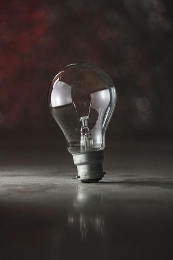 Close-up of light bulb on floor