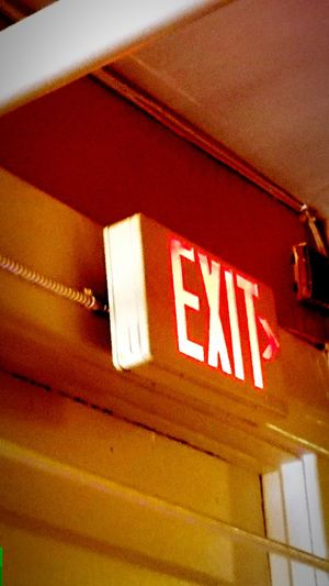 Building maintenance. Emergency exit sign. Image editorial