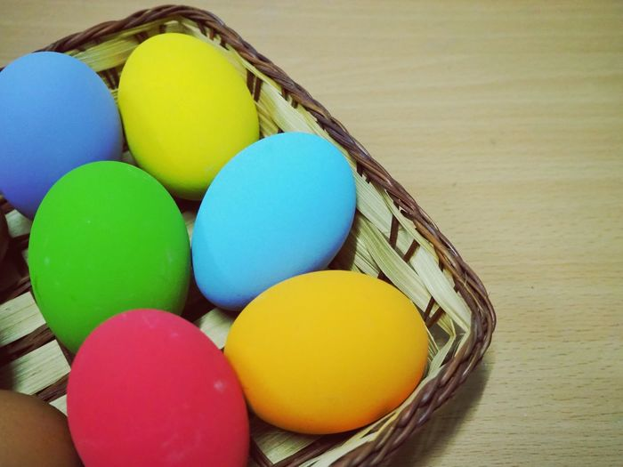 Eggs in the bamboo basket Basket Colorful Egg Multi Colored Easter Yellow Table Close-up Easter Egg