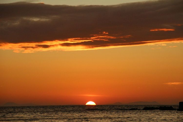 Sunset at beach Saikai City Japan Sunset Scenics Sky Beauty In Nature Sea Orange Color Tranquil Scene