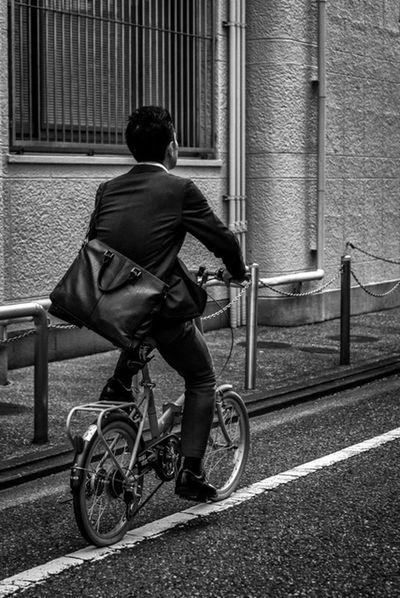 Suited for Biking Japan Japanese  ASIA Man Bicycle City Streetphotography Streetphoto_bw Panasonicgx7 Cooljapan