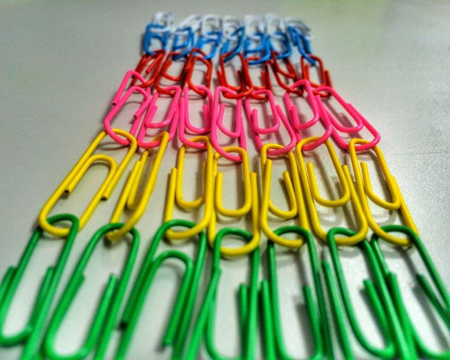 Close-Up Of Colorful Paper Clips On Table