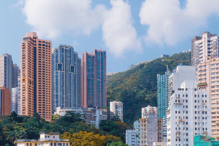 Bottom view of hong kong's residential skyscrapers. real estate in hong kong.