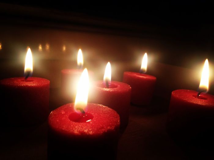 Close-Up Of Red Burning Candles