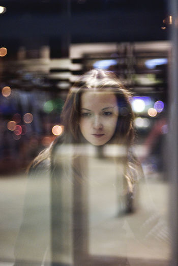 Portrait of young woman on street