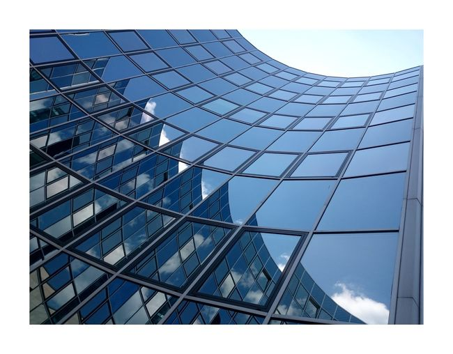 Reflection Architecture Building Exterior Built Structure Low Angle View Glass - Material Modern Building Skyscraper Glass Sky Day Blue Geometric Shape Just Taking Pictures Structures & Lines Architecture No People Urban Geometry Streetphotography Reflection Clear Sky Travel Photography Urban Scene