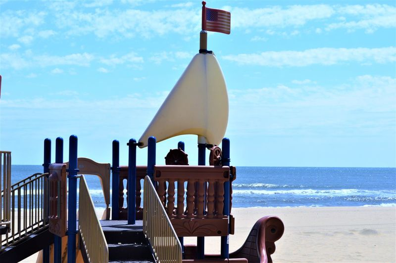 Beach Playground Sailboat~ Navy Town ~ Virginia Beach Ocean View Playground Equipment US Flag Virginia Beach Beach Beach Playground Boat Cloud - Sky Day Flag Horizon Horizon Over Water Jungle Gym Nature Navy Town No People Ocean Outdoors Playground Sailboat Sand Sea Ship Sky Water