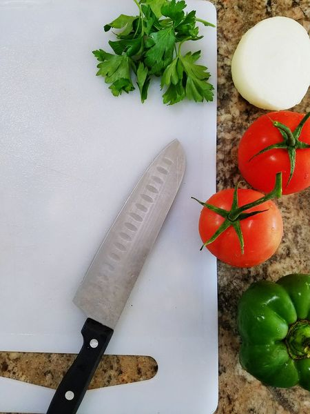 Leaf High Angle View Plant Freshness Tranquility Nature Cooking Fresh Vegetables Cutting Board Cutting Up Knife Tomatoes Onions Green Peppers White Board Top View Background Market
