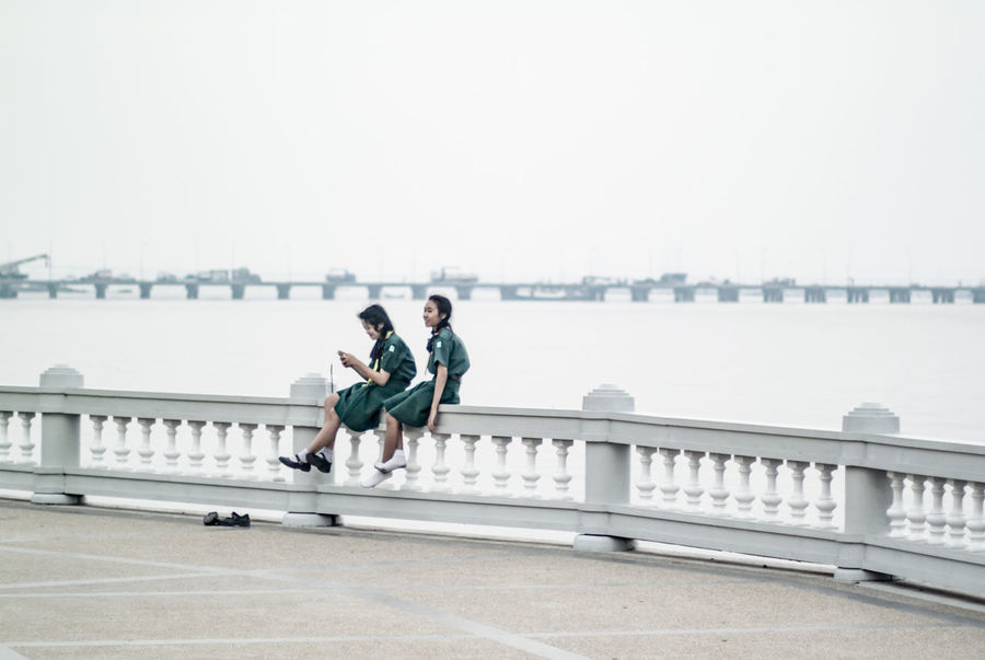 Girl Scouts Friend Friend!❤ Friendship Girl Girl Scouts Girls Leisure Activity Lifestyles Mist Relax Relaxing Rest Scouts Sea Seaside Sitting Teenage Teenager Teenagers  Teengirl White Background