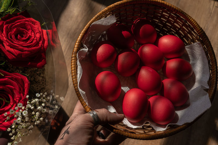 High angle view of red berries in basket