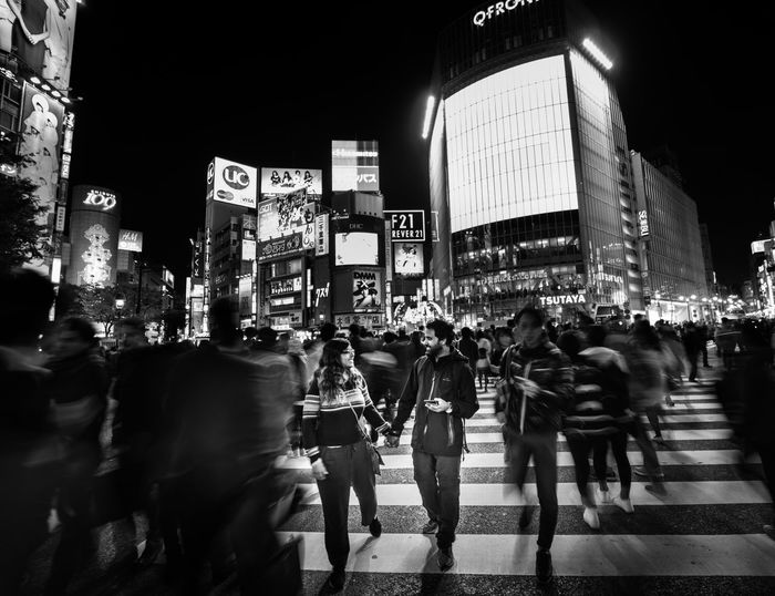 Mobile Conversations Real People Night Crowd Large Group Of People City Adults Only Men People Women Illuminated Outdoors Adult Architecture Long Exposure Building Exterior Rush Hour The City Light Shibuya crossing Tokyo Long Goodbye