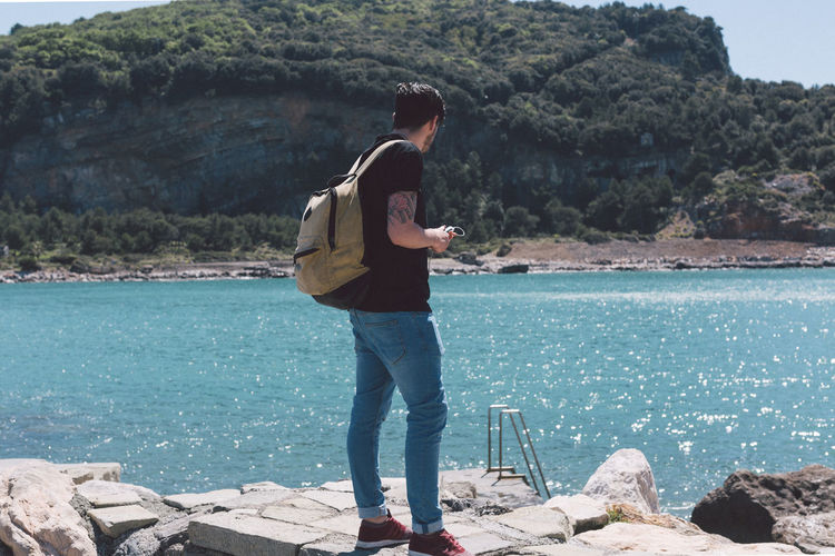 Backpack Beauty In Nature Casual Clothing Day Italy Landscape Leisure Activity Lifestyles Men Nature Outdoor Photography Outdoors Real People Rear View Scenics Standing Travel Travel Destinations Water Young Adult