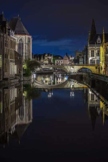Scenic view of old town and canal with reflections