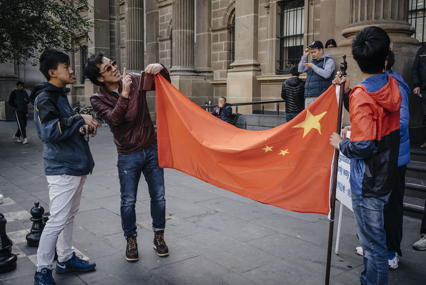 """On 23 July 2016 in a rarely occur protest, hundreds of Australian Chinese marched through the city of Melbourne to protest an international tribunal ruling against China's actions in the South China Sea. The groups are calling on the Australian government to maintain its policy of """"not taking sides"""" in the escalating territorial and diplomatic stoush. Australia Australian Chinese Melbourne MelbournePhotographer Outdoors Peaceful Protest Photojournalism Political Protest Rally Reportage Sony Australia SonyA7s South China Sea Dispute Streets Of Melbourne VSCO"""