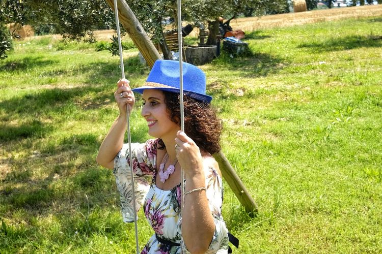 beautiful woman on swing Free Freedom Happiness Hat Beauty Casual Clothing Day Females Field Girls Grass Hairstyle Holding Land Leisure Activity Lifestyles Nature One Person Outdoors Plant Real People Sunlight Swing Women