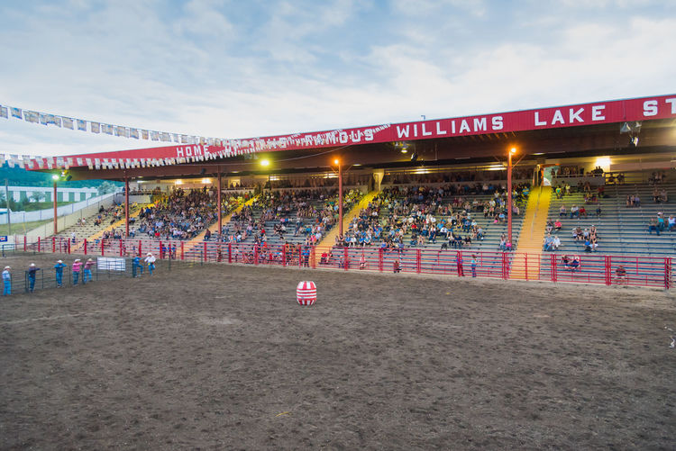 Williams Lake, British Columbia/Canada - June 30, 2016: the Williams Lake Stampede Park arena and stands is home to one of the largest stampedes in North America 90th Williams Lake Stampede Arena British Columbia, Canada Cariboo Chilcotin Rodeo Travel Williams Lake Williams Lake Stampede Park Audience Competition Country Western Crowd Documentary Editorial  Evening Extreme Sport Grounds June Professional Rodeo Sport Stampede Stampede Grounds Stands Sunset Tourism