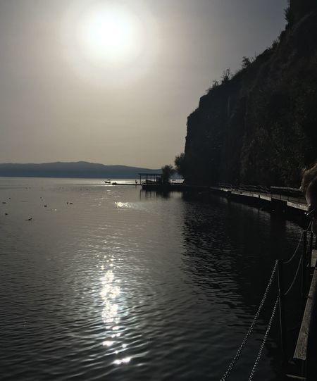 Sun shining over calm lake