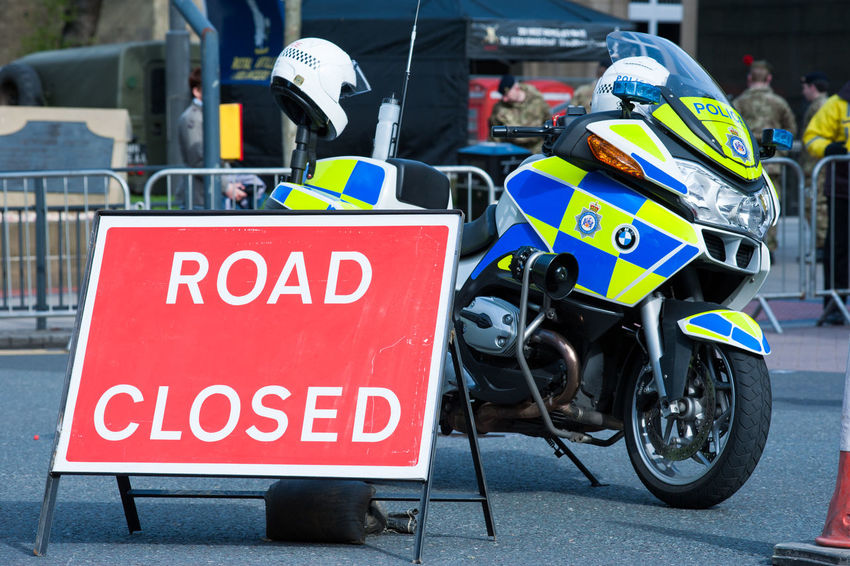 Police motorcycle and road closed sign. Authority City Closed Road Focus On Foreground Helmet Police Police Cycle Police Motorcycle Road Closed Sign Safety Street Urban Warning Sign